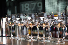 Empty Wine glasses on the background of the bar Stock Image