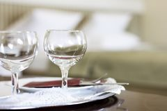 Empty wine glasses in the bedroom Royalty Free Stock Image
