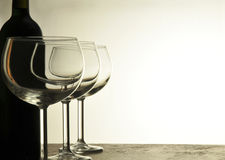 Empty Wine Glasses and Bottle Stock Photography