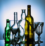 Empty Wine Glasses and Bottles Stock Images