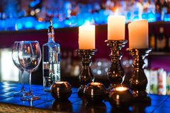 Empty wine glasses and candles with illumination lights background stock photos