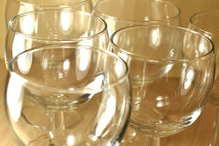 Empty wine glasses closeup. Background pattern of empty crystal glasses on a wooden background stock photo