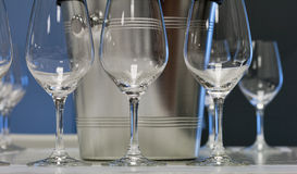 Empty wine glasses with ice bucket closeup Royalty Free Stock Photos