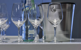 Empty wine glasses with ice bucket closeup Royalty Free Stock Photography
