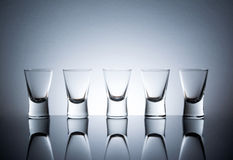 Empty wine glasses with reflection standing in a row Stock Image