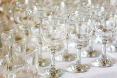 Empty wine glasses standing in row on table royalty free stock image