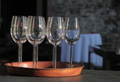 Empty wine glasses on tray Stock Images