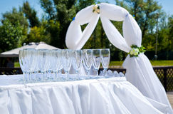 Empty wine glasses on the wedding ceremony Stock Photos