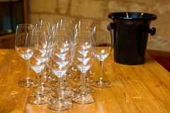 Empty wine glasses. Empty wine glasses on wooden table, ready for wine tasting Royalty Free Stock Images