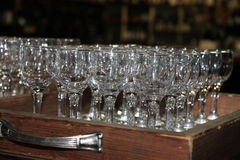 Empty wine glasses- zoom in. Empty wine glasses on a wooden tray Stock Image