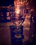 Empty wineglass reflecting lights royalty free stock images