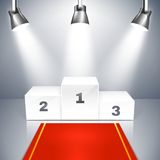 Empty winners podium with spotlights. Vector illustration of a red carpet leading to an empty winners podium with three places illuminated by overhead metallic Stock Image