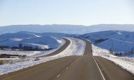 Winter roads in Montana. Empty winter interstate highway in Montana Royalty Free Stock Photos