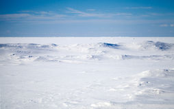 Deep blue sky and snow on frozen Baltic Sea Stock Images