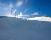 Empty winter snow halfpipe Royalty Free Stock Photo