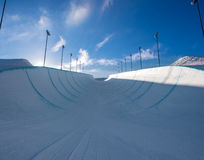 Empty winter snow halfpipe Royalty Free Stock Image