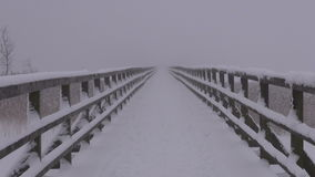 Empty winter wooden snowy bridge and morning fog stock video footage