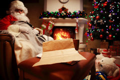 Empty wishlist for Santa Claus laid on a wooden table. Stock Photo
