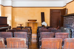 Empty witness chair inside a classic American courtroom. Stock Photos