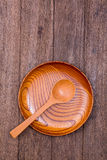 Empty wood bowl and spoon Royalty Free Stock Images