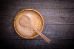 Empty wood bowl and spoon Stock Photography