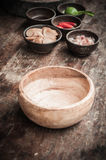 Empty wood bowl on wooden floor Stock Image