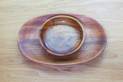Empty wood bowl. On wooden table background Royalty Free Stock Image