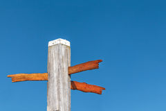 Wood carved direction signs on a beach pole Stock Photography