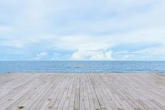 Empty wood deck pier with sea ocean view. Background calm and tranquil stock image