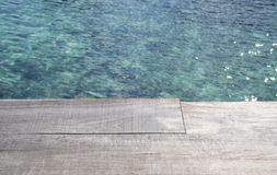 Empty wood desk and summer blue sea background .Blank space for text and images.  Stock Photos