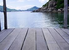 Empty wood desk and summer blue sea background .Blank space for text and images.  Stock Image