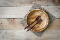 Empty wood dish with spoon and fork on wooden texture background Stock Photography