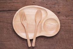 Empty wood dish. On wooden background Stock Photography