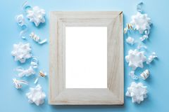 Empty wood Photo Frame with Birthday Party Decorations on blue background royalty free stock photos