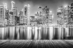 Empty wood plank with modern cityscape building at night in mono Stock Photo