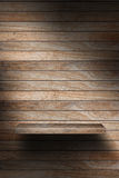 Empty wood shelf. Grunge industrial interior Uneven diffuse lighting version. Design component royalty free stock photography