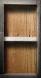 Empty wood shelf. On wooden wall stock image