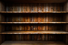 Empty wood shelf. 3D empty wood shelf: grunge interior for your objects royalty free stock photo