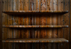 Empty wood shelf. 3D empty wood shelf: grunge interior for your objects stock images