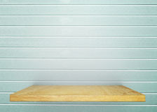 Empty wood shelf on bare with light blue vintage wall. Product d. Isplay template. Business presentation stock photo