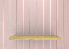 Empty wood shelf on bare with pink vintage wall. Product display template. Business presentation royalty free stock image