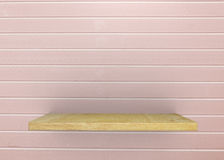 Empty wood shelf on bare with pink vintage wall. Product display template. Business presentation stock images