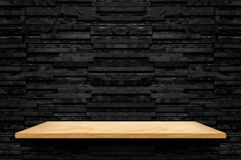 Empty wood shelf at black layer marble tile wall background,Mock up for display or montage of product or design,modern interior d royalty free stock photo