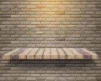 Empty wood shelf on brick wall background. Empty wood shelf on vintage grunge brick wall background royalty free stock images