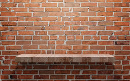 Empty wood shelf on brick wall Royalty Free Stock Photos