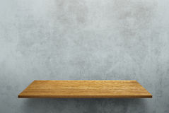 Empty wood shelf on loft style wall texture Stock Photos
