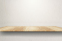 Empty wood shelf on white wall Stock Photography