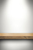 Empty wood shelf on white wall Royalty Free Stock Photo