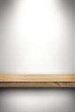 Empty wood shelf on white wall. Empty brown wood shelf on white wall Royalty Free Stock Photo