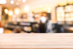 Empty wood table with Blur coffee shop or cafe restaurant with a. Bstract bokeh light image background. For create montage product display. modern lifestyle Royalty Free Stock Photos